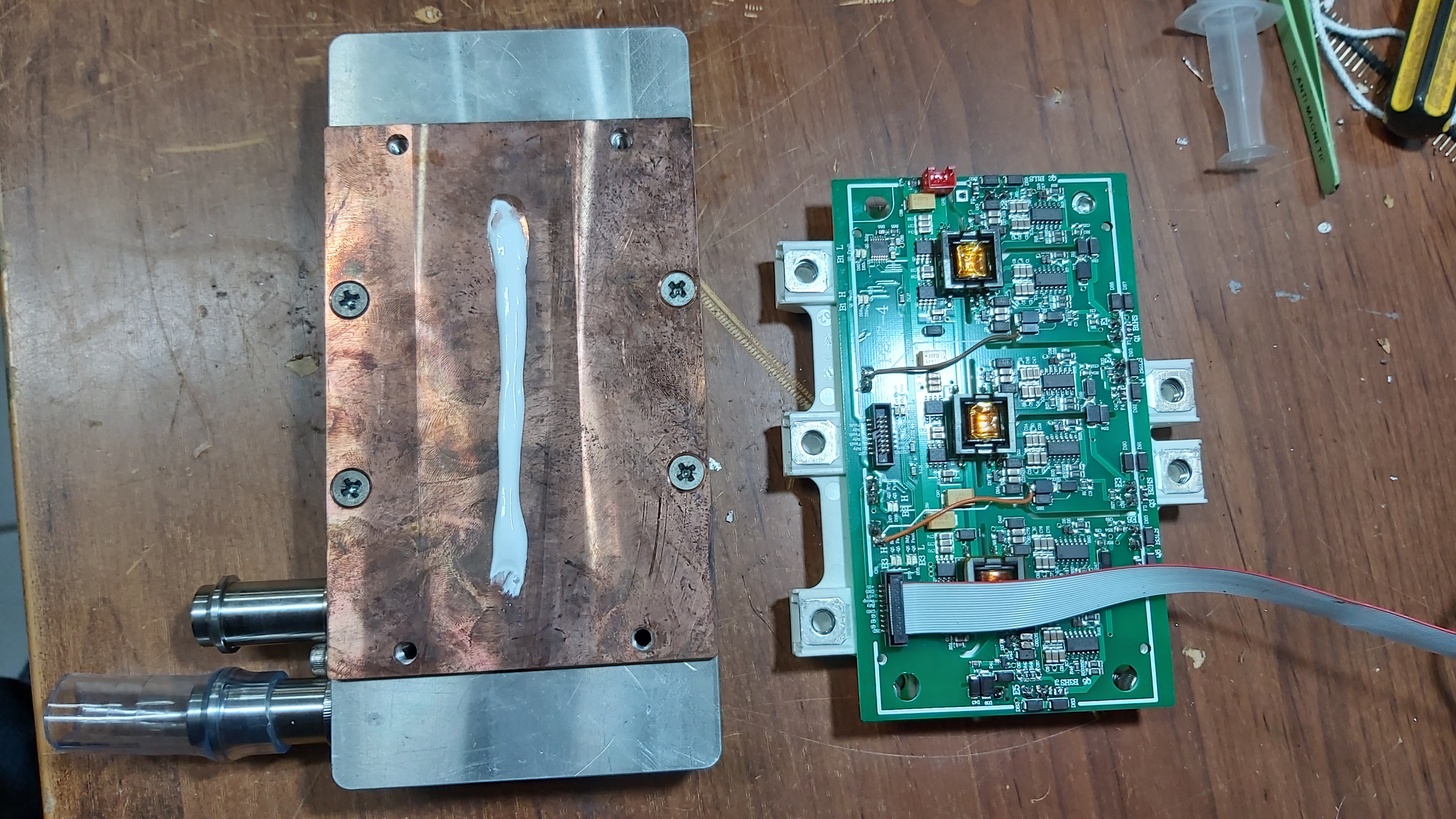 Thermal grease on cooling plate.
