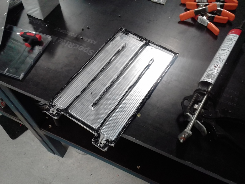 Cooling plate adhesive on.jpg